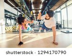 sporty couple doing push ups... | Shutterstock . vector #1294170790
