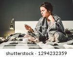 a young caucasian woman sits on ... | Shutterstock . vector #1294232359
