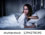 woman relaxing at  home  on the ... | Shutterstock . vector #1294278190