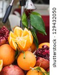 fresh oranges and pomegranates... | Shutterstock . vector #129432050