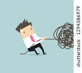 businessman trying to unravel... | Shutterstock .eps vector #1294386979