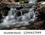 long exposure of a waterfall in ... | Shutterstock . vector #1294417999