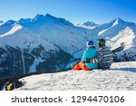 skier and snowboarder at rest... | Shutterstock . vector #1294470106