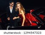 Couple In Luxury Car. Night...
