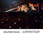 couple in luxury car. night... | Shutterstock . vector #1294547329