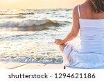 woman meditating at the sea   Shutterstock . vector #1294621186