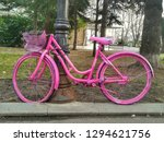 an old pink wheel locked for... | Shutterstock . vector #1294621756