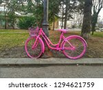an old pink wheel locked for... | Shutterstock . vector #1294621759