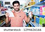 happy  positive smiling man is... | Shutterstock . vector #1294626166