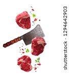 Raw Marbled Ribeye Steak And...