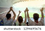 football fans raising hands ... | Shutterstock . vector #1294695676