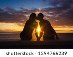 man and woman sitting by the... | Shutterstock . vector #1294766239