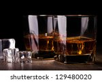 glass with whiskey on wooden... | Shutterstock . vector #129480020