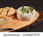 baked camembert with walnuts ... | Shutterstock . vector #1294827979