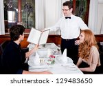 man and woman in restaurant... | Shutterstock . vector #129483650