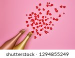 two champagne bottles with red... | Shutterstock . vector #1294855249