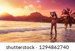 free woman enjoys ocean breeze... | Shutterstock . vector #1294862740
