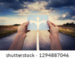 hands holding paper with arrows ... | Shutterstock . vector #1294887046