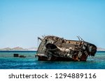 a badly corroded shipwreck of a ... | Shutterstock . vector #1294889116