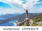 hiker girl on the mountain top  ... | Shutterstock . vector #1294930279