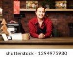 photo of brunette seller in... | Shutterstock . vector #1294975930