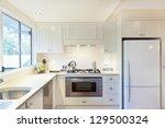 modern gourmet kitchen interior | Shutterstock . vector #129500324