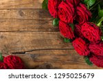 Stock photo luxury bouquet made of red roses on dark rustic background top view copy space 1295025679