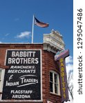 Small photo of Flagstaff, Arizona - March 25, 2017: Detail of the advertising on the side of the historic Babbitt Brothers building in Flagstaff. Built in 1888, it now houses Babbitt's Backcountry Outfitters.