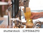lager being poured into a pint... | Shutterstock . vector #1295066293
