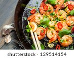 Shrimps sauteed with garlic and butter - stock photo