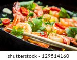 Closeup of tasting Fried shrimp with chopsticks - stock photo