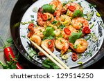 Closeup of shrimps sauteed with chilli pepper - stock photo