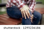 male suffers from knee pain ... | Shutterstock . vector #1295236186