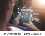 young women using phones to... | Shutterstock . vector #1295260216