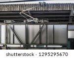 pantograph of the commuter train | Shutterstock . vector #1295295670
