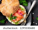 smoked salmon sandwich with... | Shutterstock . vector #1295330680