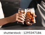 friends with glasses of tasty... | Shutterstock . vector #1295347186