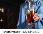 woman with glass of refreshing... | Shutterstock . vector #1295347213