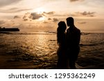 silhouettes of bride and groom... | Shutterstock . vector #1295362249