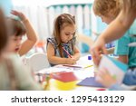 group of children drawing with... | Shutterstock . vector #1295413129