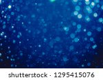 abstract blue defocused bokeh... | Shutterstock . vector #1295415076
