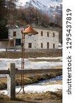 an ancient rusty alpine... | Shutterstock . vector #1295437819
