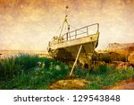 old rusty boat at seashore with ...   Shutterstock . vector #129543848