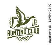 hunting logo  duck hunting stamp | Shutterstock .eps vector #1295442940