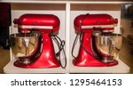 red kitchen mixers on the shelf. | Shutterstock . vector #1295464153