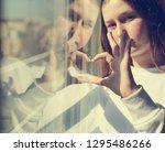 attractive sad teenage girl... | Shutterstock . vector #1295486266