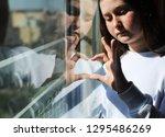 attractive sad teenage girl... | Shutterstock . vector #1295486269