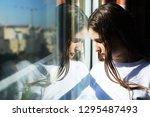 attractive sad teenage girl... | Shutterstock . vector #1295487493