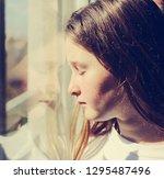 attractive sad teenage girl... | Shutterstock . vector #1295487496