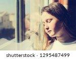 attractive sad teenage girl... | Shutterstock . vector #1295487499